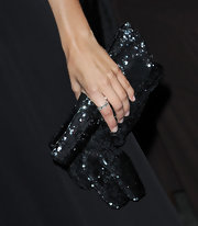 Camilla carried a sequin covered clutch while walking the red carpet at a Pre-Oscar party.