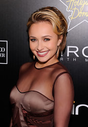 Hayden wore her mesh gown with dark berry lipstick.