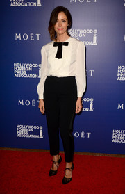 Abigail Spencer went for an androgynous vibe in a white Dolce & Gabbana tuxedo top styled with a black bow during the Hollywood Foreign Press Association's Grants Banquet.