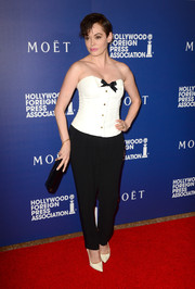 Rose McGowan balanced out her sexy top with basic black slacks.