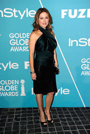 Sasha Alexander showcased her arms in a silk forest halter top.