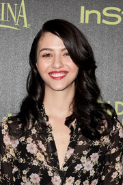 Katie Findlay styled her hair with vintage-inspired curls for the Golden Globe Award season celebration.