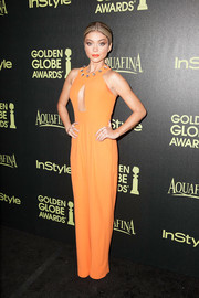 Sarah Hyland showed off her vibrant-chic style with this orange Giulietta jumpsuit, featuring a cleavage-baring cutout and an embellished neckline, at the Golden Globe Award season celebration.