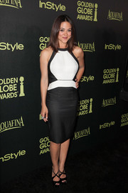 Camille Guaty completed her outfit with a pair of black crisscross-strap sandals.