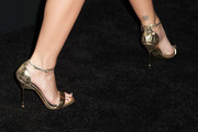 Emily Ratajkowski sports a window tattoo at the back of her left ankle.