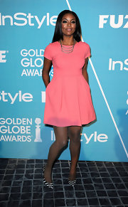 Gabrielle Union punched up her coral fit-and-flare frock with printed stilettos.