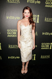 Katie Stevens oozed sexy elegance in a gold jacquard strapless dress during the Golden Globe Award season celebration.