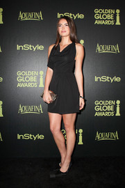 Katherine C. Hughes added shine to her dark outfit with a textured gold box clutch.