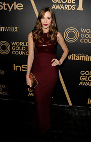 Christa was precisely on-trend in this oxblood gown with a patent leather bodice.