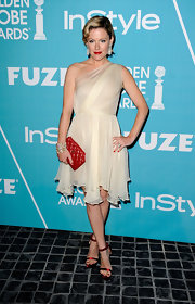 Kathleen Robertson was on trend for the holidays in red satin strappy sandals.