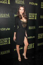 Emily Ratajkowski added an extra flash of gold via a pair of Kurt Geiger ankle-strap sandals.