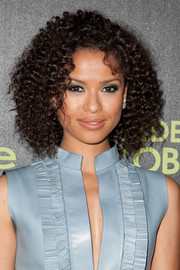 Gugu Mbatha-Raw achieved a bold beauty look with lots of metallic silver eyeshadow.