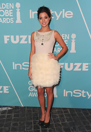 Gia paired her feathery frock with heavy black platform pumps. The dark heels were an unexpected choice for the flirty dress.