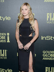 Olivia Holt styled her hair with long curls to frame her face.
