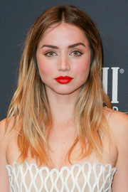 Ana de Armas topped off her look with a radiant red lip.