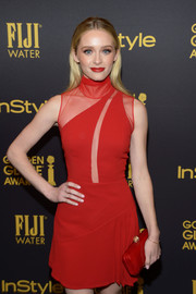 Greer Grammer was flirty and feminine at the HFPA and InStyle Golden Globe Award season celebration in a red Cengiz Abazoglu mini dress with a sheer-panel bodice.