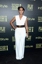 Tracee Ellis Ross wore a V-neck form-fitted crisp white dress that showed off the star's figure.