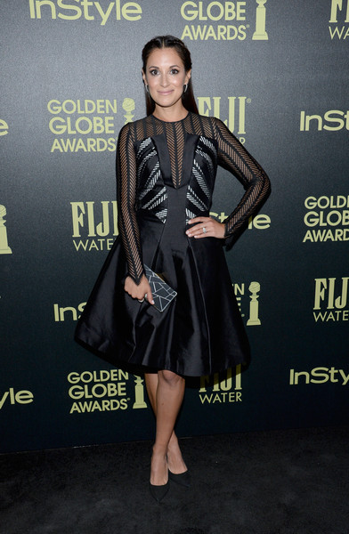 Angelique Cabral wore a long-sleeved printed dress with a sheer top and v-neckline.