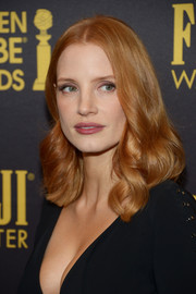 Jessica Chastain was perfectly coiffed with this center-parted curly 'do at the HFPA and InStyle Golden Globe Award season celebration.