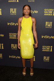Naomie Harris sealed off her look with a pair of Nicholas Kirkwood ankle-cuff sandals.
