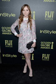 Tara Lynne Barr wore a long-sleeved printed dress with a white collar and cuffs for an elegant look