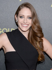 Carly Chaikin styled her hair in a side-parted curled look.
