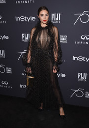 Olivia Culpo completed her look with a metallic gold purse.