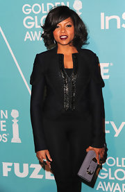 Taraji added a lovely dose of color to her monochromatic look with a lavender patent leather clutch.