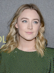 Saoirse Ronan styled her hair in a light wavy cut that flowed just below her shoulders
