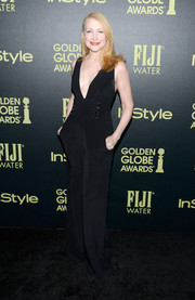 Patricia Clarkson donned a plunging V-neck black jumpsuit with button details, wide-leg pants, and pockets.