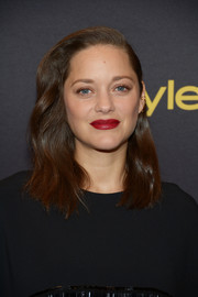 Marion Cotillard wore a gently wavy, half-pinned 'do at the HFPA and InStyle Golden Globe Award season celebration.