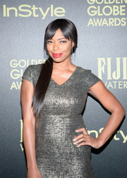 Jill Marie Jones looked chic with a loose side ponytail and sweeping bangs.