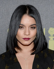 Vanessa Hudgens styled her hair in a chic straight cut with textured layers to frame her face.