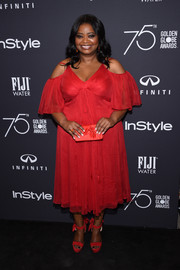 Octavia Spencer looked romantic in a red cold-shoulder cocktail dress by Tadashi Shoji at the Golden Globes 75th anniversary celebration.