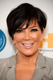 Kris Jenner looked fab wearing her hair in a shiny short layered style with oversize hoop earrings.