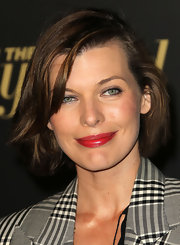Milla Jovovich amped up her look with a touch of cherry red lip gloss.