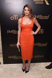 Ashley Greene oozed sex appeal in a low-cut, figure-hugging red-orange dress by Narciso Rodriguez at the Hollywood Reporter's 35 Most Powerful People in Media event.