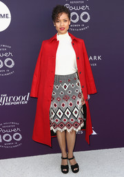 Gugu Mbatha-Raw arrived for the Hollywood Reporter's 2017 Women in Entertainment Breakfast looking bright in her red wool coat.