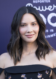 Olivia Munn wore her hair down to her shoulders in subtle waves at the Hollywood Reporter's 2017 Women in Entertainment Breakfast.