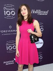 Emmy Rossum attended the Hollywood Reporter's 2017 Women in Entertainment Breakfast carrying a black leather bag with a silver chain strap.