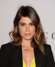 Nikki Reed left her hair loose with a side part and soft waves when she attended the Women in Entertainment Breakfast.