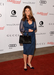 Maria Shriver chose a blue cocktail dress with a sheer overlay for the Women in Entertainment Breakfast.
