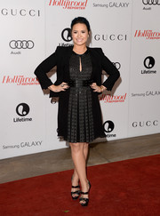Demi Lovato layered a black Helmut Lang blazer over her edgy dress for a more formal finish.