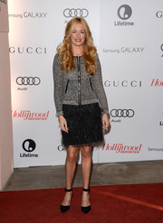 Cat Deeley paired her cardigan with a feathered black mini skirt for a dressier finish.