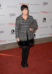 Kris Jenner teamed over-the-knee black suede boots with a mini skirt and a tweed jacket for the Women in Entertainment Breakfast.