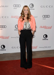 Molly Sims finished off her smart ensemble with a pair of flared black slacks.