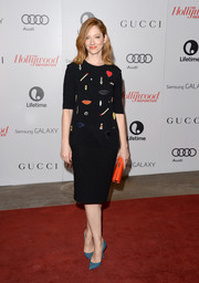 Judy Greer added more color via a pair of pointy blue pumps.