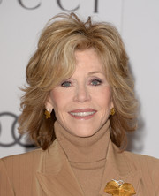 Jane Fonda styled her locks with feathered layers for the Women in Entertainment Breakfast.