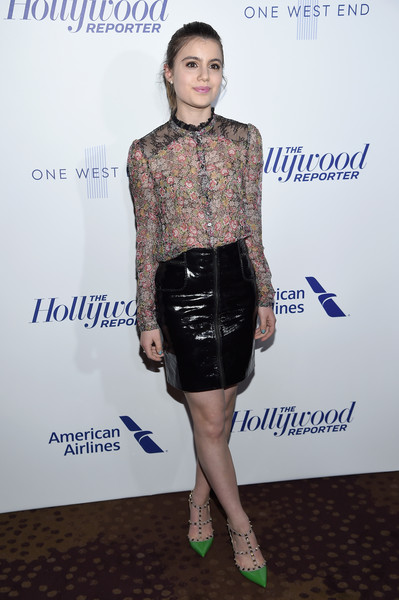 Sami Gayle contrasted her demure top with a fetish-chic patent mini.