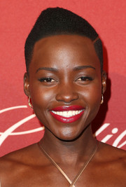 Lupita Nyong'o topped off her look with a pointy side-parted 'do when she attended the Hollywood Reporter nominees night party.
